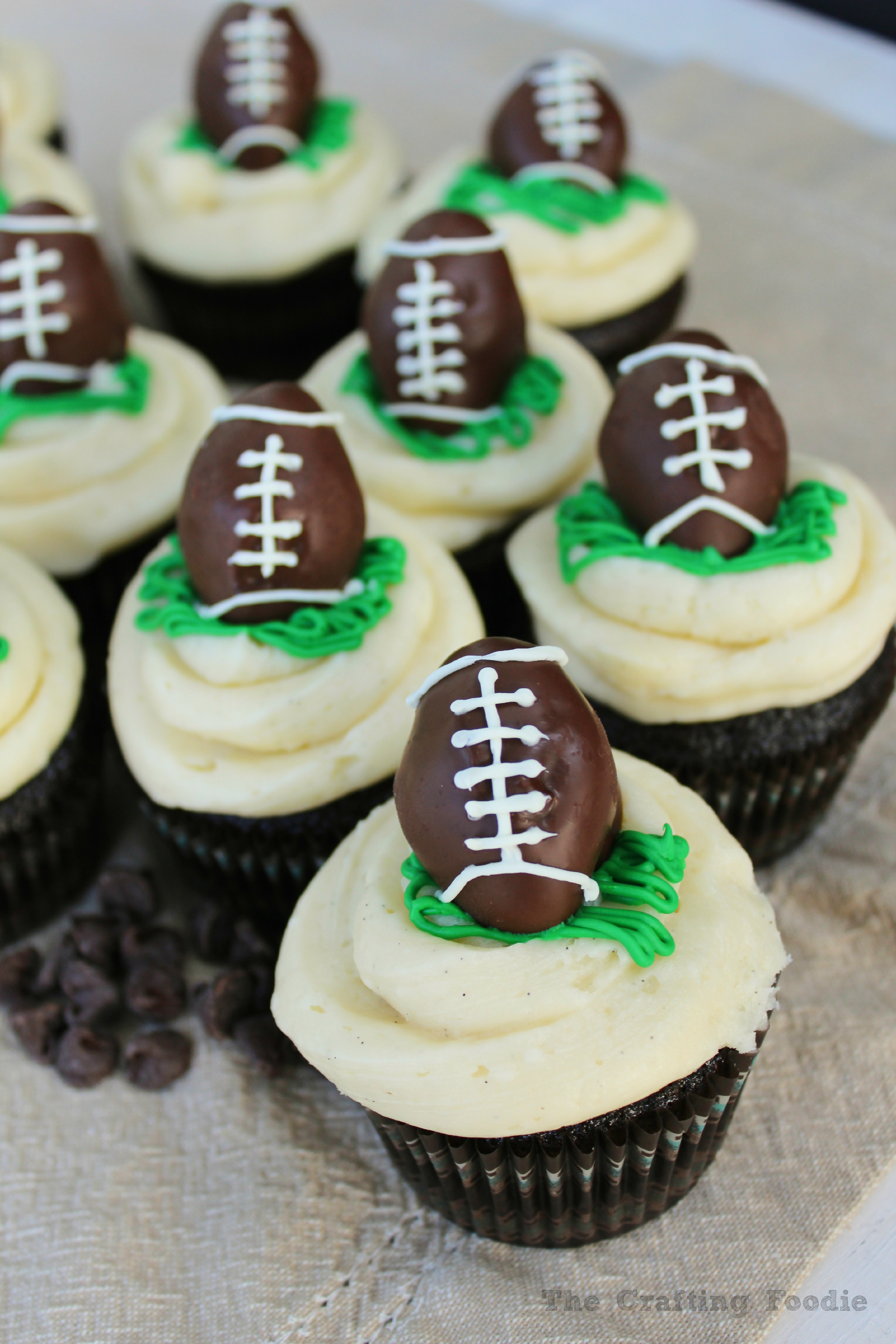 Chocolate Cupcakes Topped With Football Cake Pops