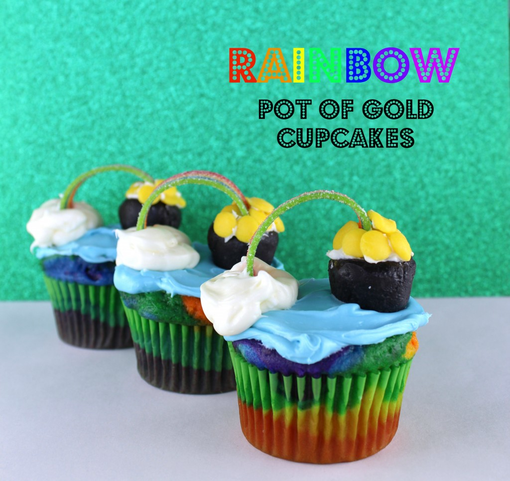 Rainbow Cupcakes Topped with a Pot of Gold at the End of a Candy Rainbow