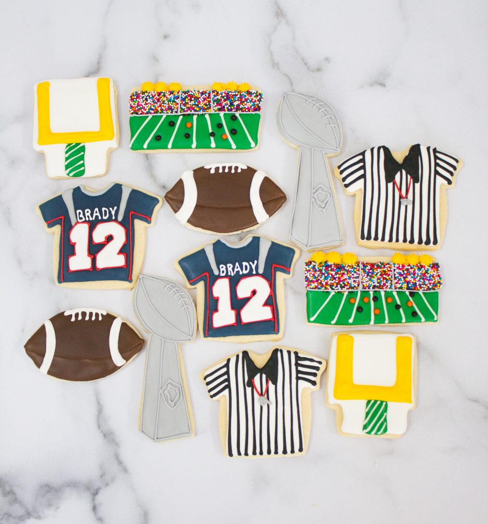 These Football Cookies for the Super Bowl are the most delicious sugar cookies topped with royal icing. This post shares which royal icing colors are used and which cookie cutters! They are so FUN!
